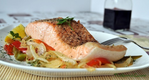 Delicious baked salmon fillet recipe with mixed pepper and onion.