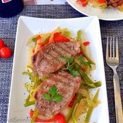 Pork shoulder steaks or Boston butt steaks, a tender Spanish Tapas recipe with vegetables called Presa Iberica