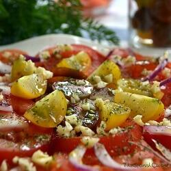 Receta de tomate aliñado con aceite, ajo y perejil